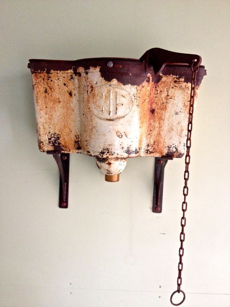 antique cast iron cistern