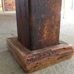 Rusted industrial steel table leg.