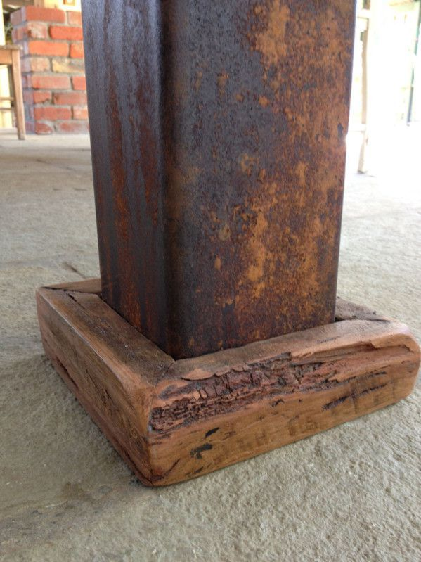 Rusted industrial steel table leg.