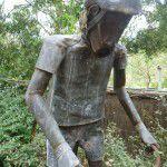 Copper and lead cyclist garden sculpture.