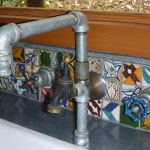 Hand crafted industrial kitchen taps with additional filtered water tap.
