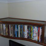 Metal DVD rack and shelf feature.