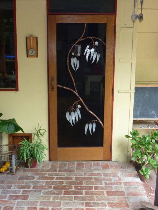 Fly wire door screen with galvanised iron and copper gum leaf design.
