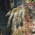 Hand detail of lead garden statue.