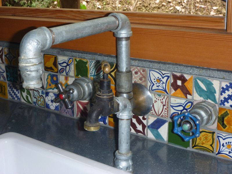 Hand crafted original sink taps including filtered water tap.